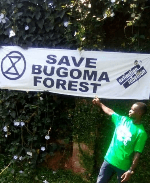 "Sign reading ""Save Bugoma Forest"""