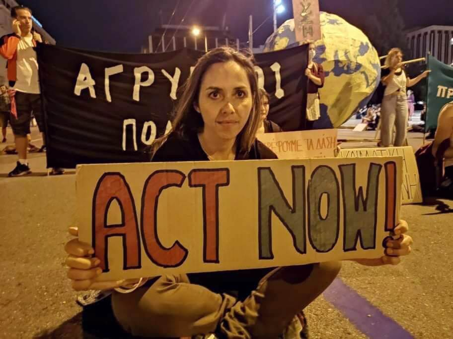 Rebel holding an Act Now sign