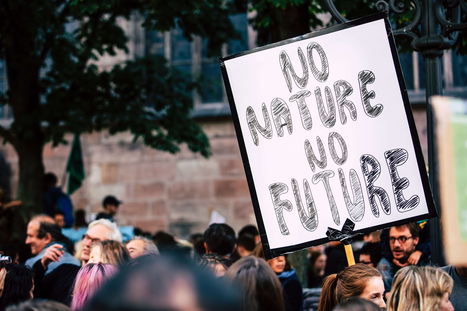 "Protesters with a sign saying ""No nature no future"""