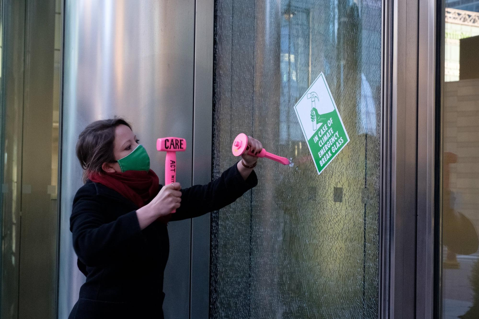 London, UK. 7 women rebels break windows of Barclays HQ, the 7th dirtiest bank, inspired by the suffragettes who broke windows in their fight to win women the vote.