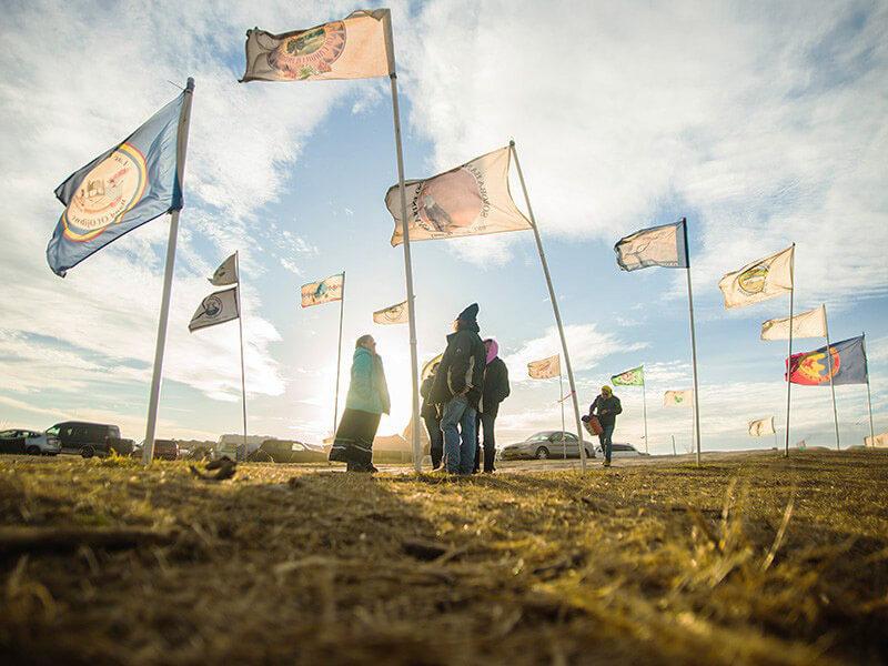 Flags fly at the Oceti Sakowin Camp near Cannonball, North Dakota