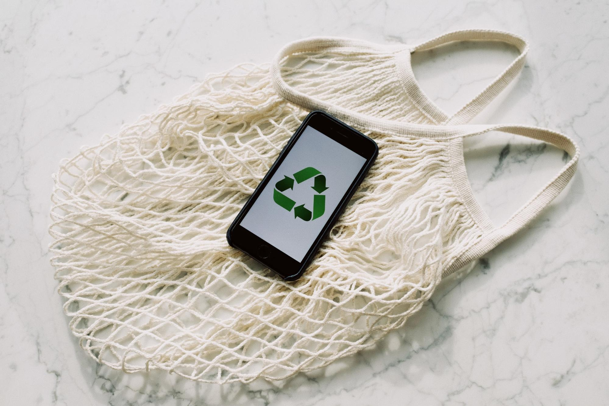 smartphone with recycle icon displayed
