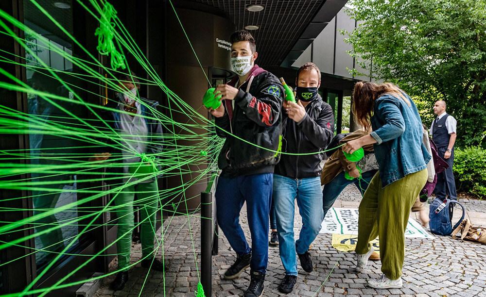 German rebels winding green thread around an entrance
