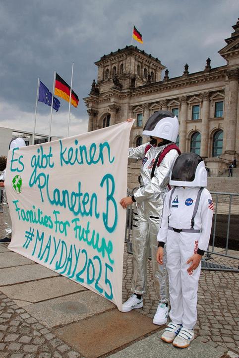 Rebels dressed as spacemen demonstrating