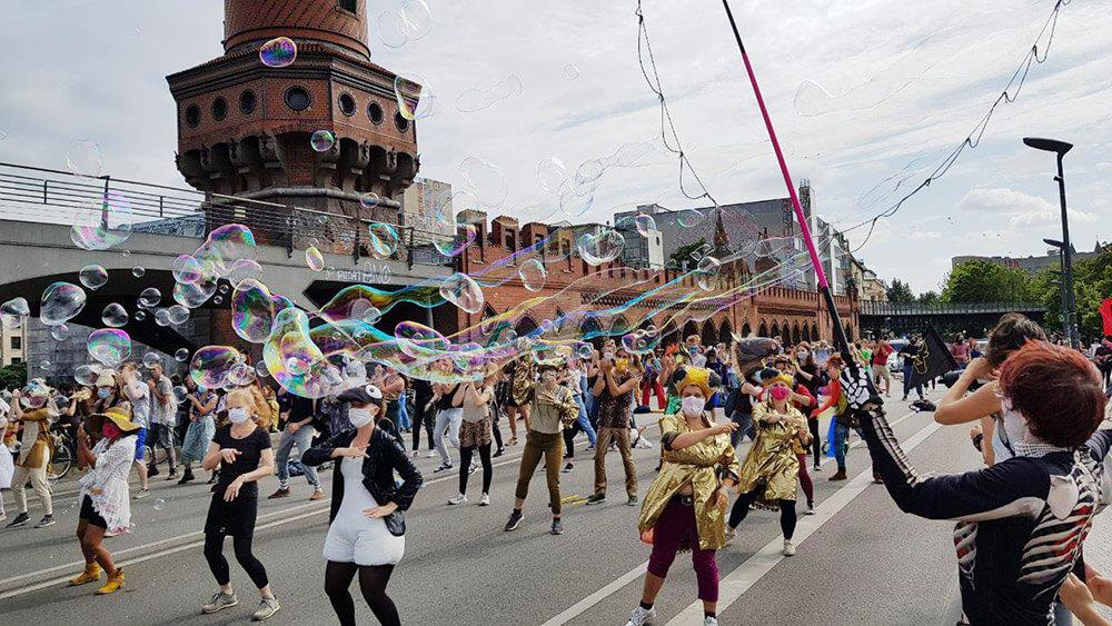 Rebels dancing on a bridge amongst bubbles