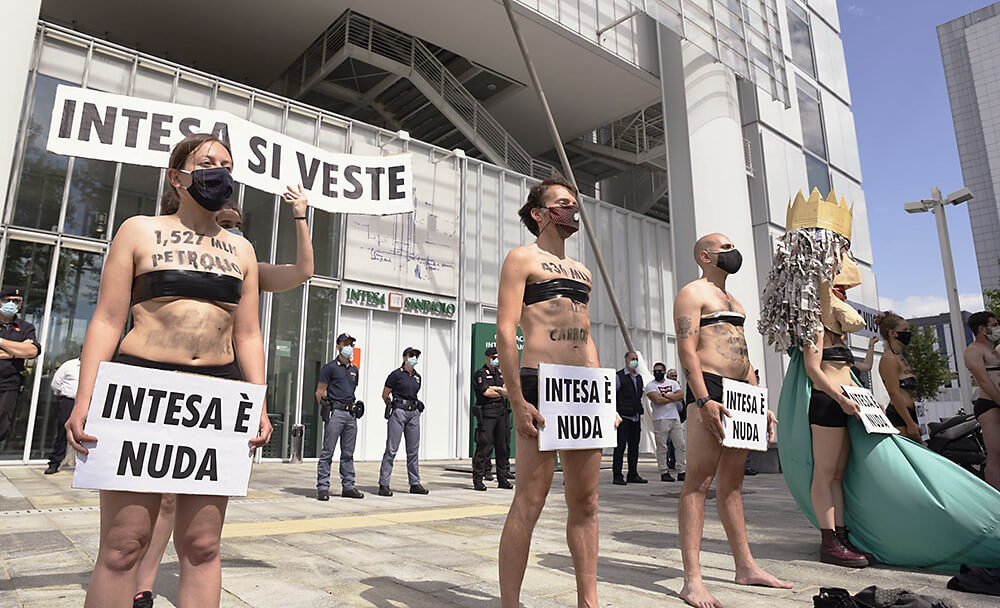 Semi-nude rebels protesting outside a bank