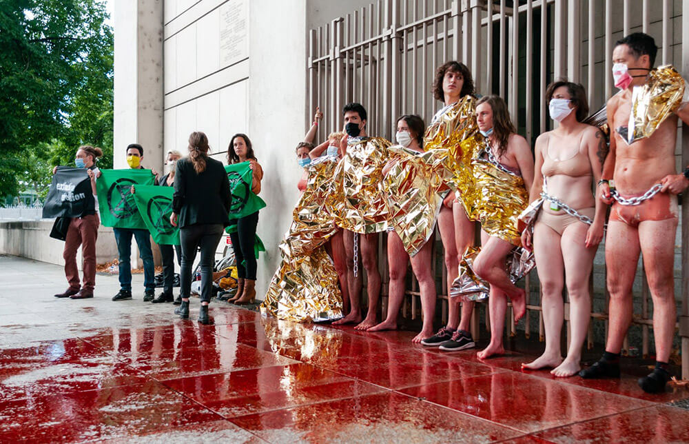French rebels, almost nude, wtih a large puddle of fake blood in front