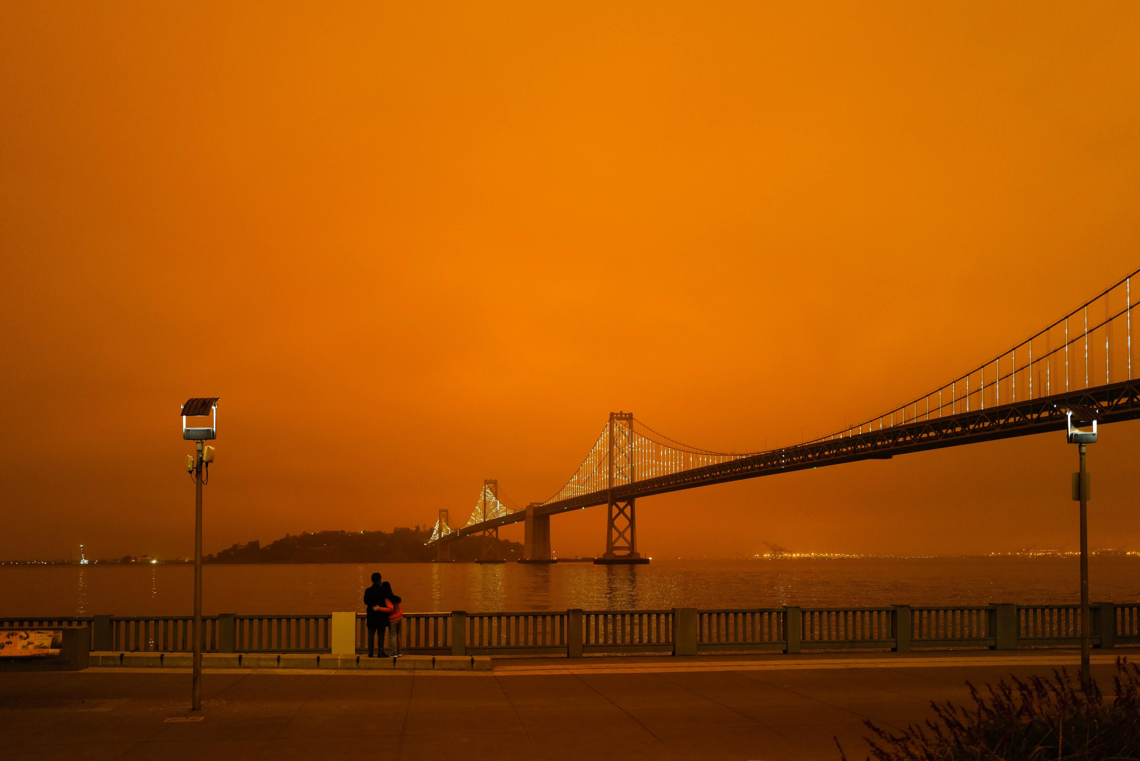 Orange sky across Golden Gate Bridge